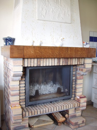 Fireplace in the kitchen of Gite en Alsace cottage